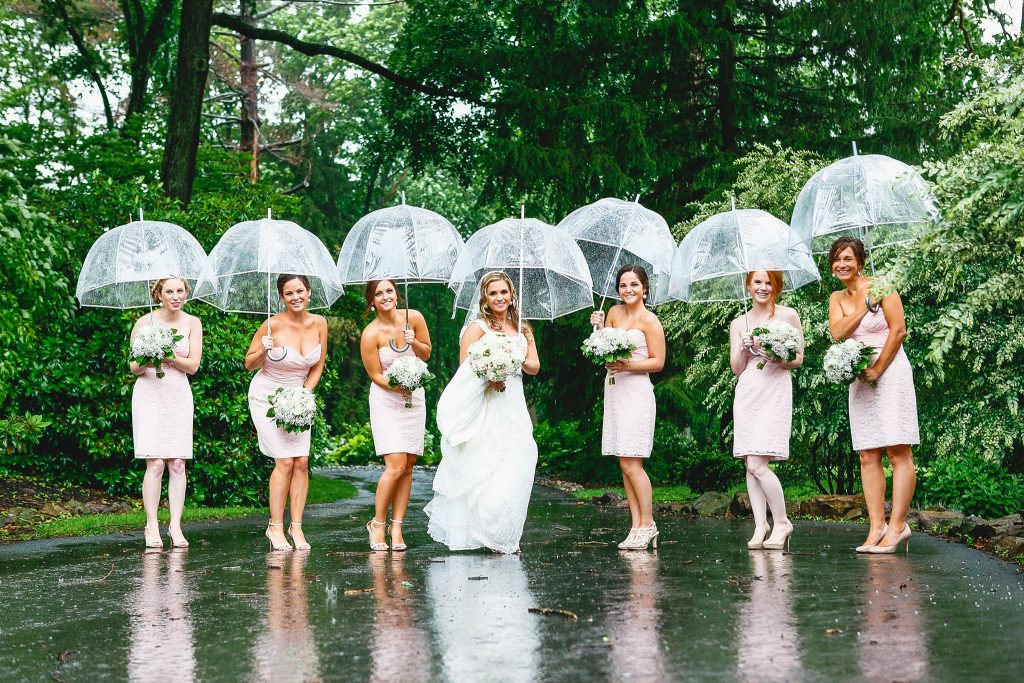 brides and bridesmaids in the rain